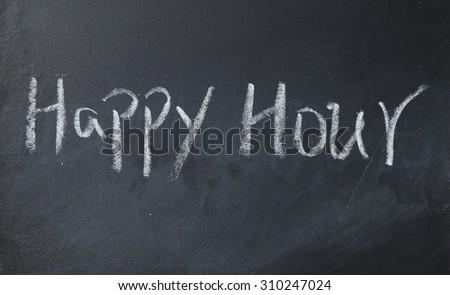 happy hour text write on blackboard - stock photo