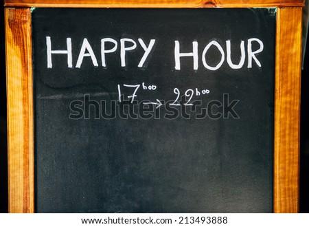 Happy Hours handwritten with white chalk on a blackboard - stock photo