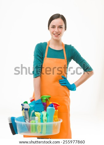 happy housewife getting ready for spring cleaning. standing against white background - stock photo