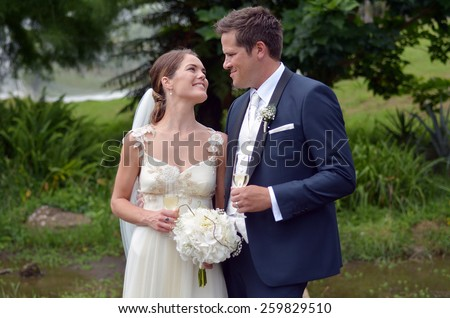Happy Husband and wife on their wedding Day. Concept of wedding, relationship and marriage. copy space - stock photo