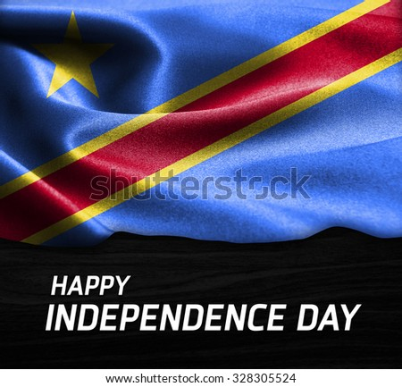 Happy Independence Day Democratic Republic of the Congo flag on wood Texture background - stock photo
