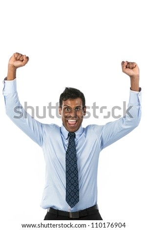 Happy Indian business man celebrating his success. - stock photo