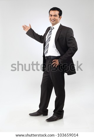 Happy indian business man giving presentation - stock photo