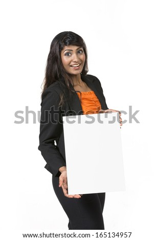 Happy Indian businesswoman holding a white banner and smiling. Isolated on white background.