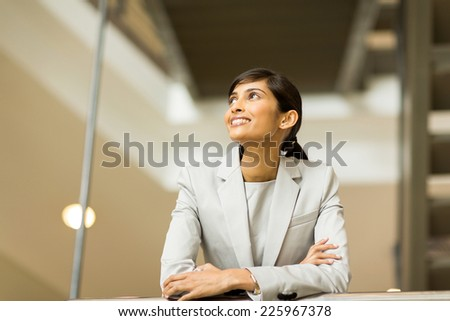 happy indian businesswoman looking up - stock photo