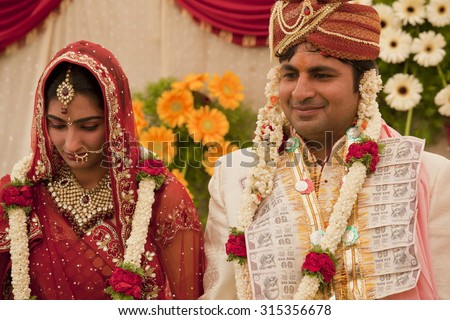 Happy Indian Couple At Their Wedding