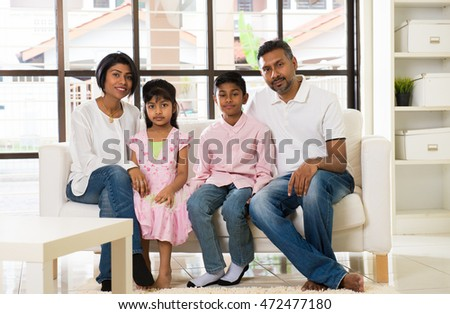 happy indian family at living room