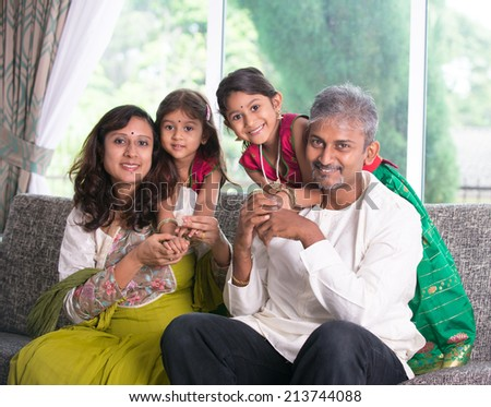 happy indian family enjoying quality time at home indoor  - stock photo