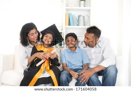 Happy indian family graduation, education concept photo  - stock photo