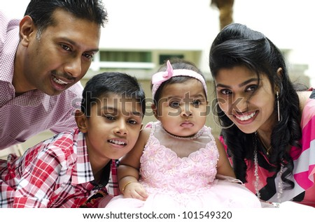 Happy Indian family having fun time at outdoor - stock photo