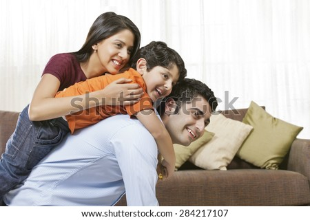 Happy Indian family of three at home