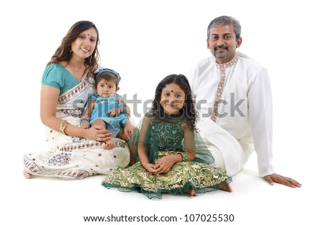 Happy Indian family sitting on white background - stock photo