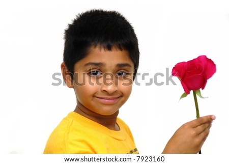Happy Indian kid holding a rose for valentine - stock photo