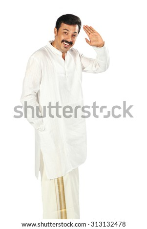 Happy Indian man showing some action with his hands.He is using traditional dress called juba. - stock photo