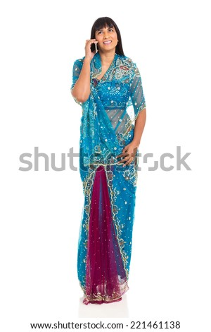 happy indian woman talking on her mobile phone - stock photo
