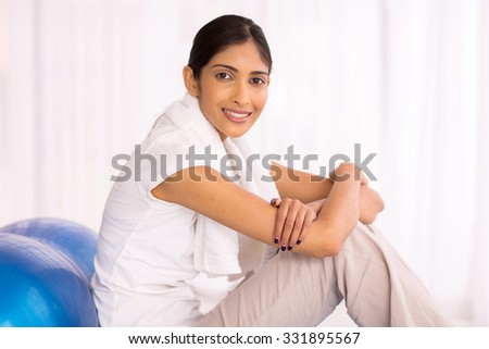 happy indian woman with exercise ball at home