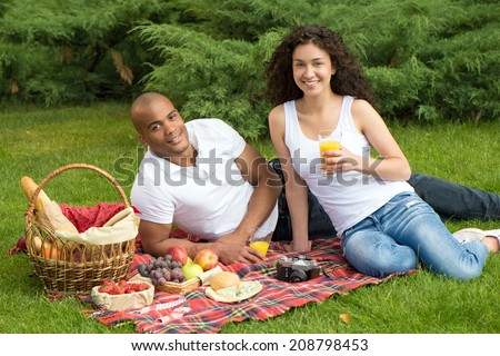 Happy international couple having a picnic
