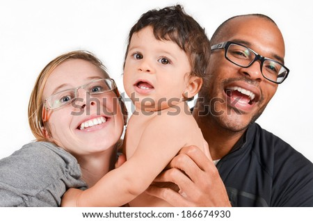 Happy interracial family is laughing - stock photo