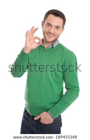 Happy isolated man in green making excellent symbol. - stock photo