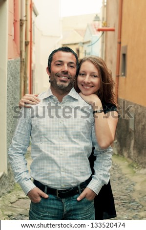 Happy italian man and young woman, retro style - stock photo