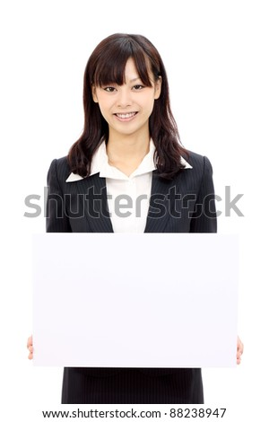 Happy japanese business woman holding blank card and smiling, white background