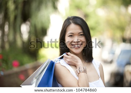happy japanese woman with shopping bags - stock photo