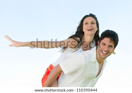 Happy joyful couple enjoy the freedom of the summer