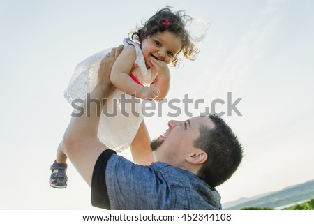 happy joyful father with daughter