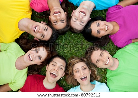 Happy joyful group of young friends enjoy together the life outdoor