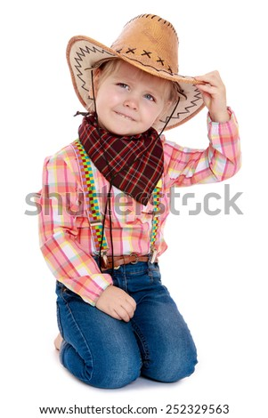 Happy joyful little girl dressed as a cowboy and a big hat on his head.Isolated on white background, Lotus Children's Center.