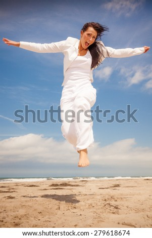 happy jumping successful female on weekend travel - stock photo
