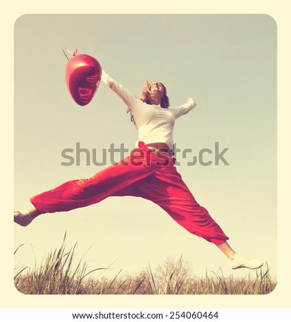 Happy jumping woman - stock photo