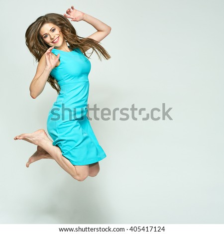 Happy Jumping woman isolated portrait. Long hair in motion. Blue, azure dress. - stock photo