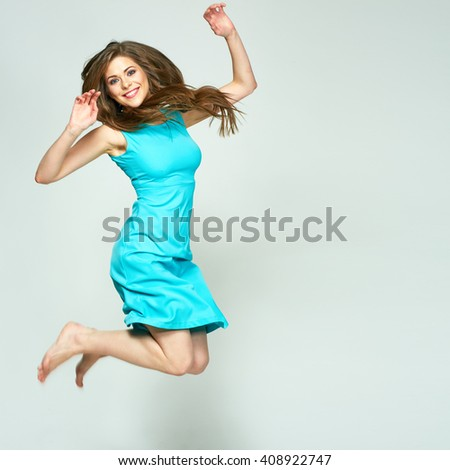 Happy Jumping woman isolated portrait. Long hair in motion. Blue, azure dress.