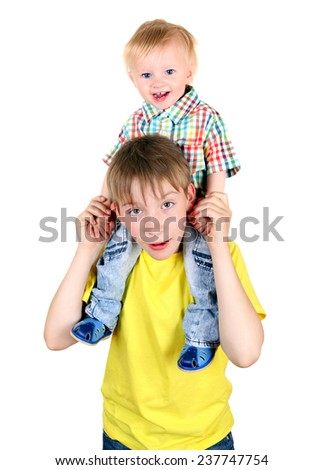 Happy Kid and Baby Boy Isolated on the White Background - stock photo