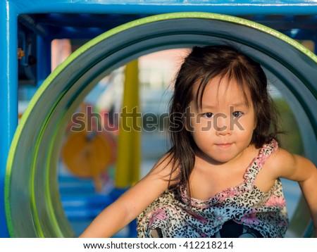 Happy kid, asian baby child playing on playground - stock photo