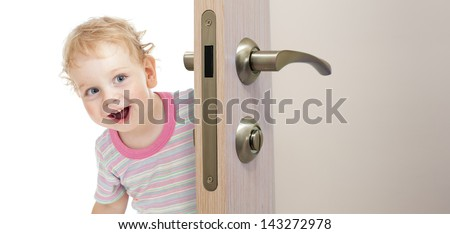 happy kid behind door - stock photo