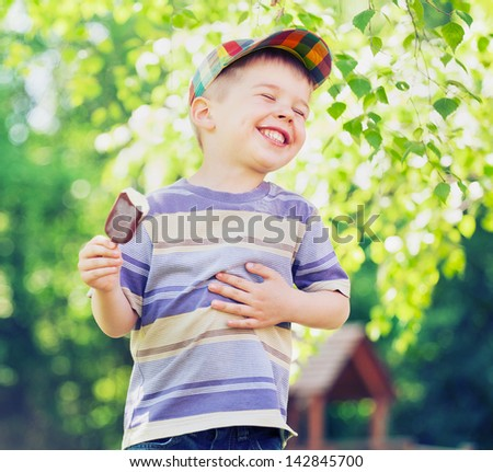 happy kid boy eating ice cream - stock photo
