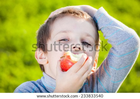 happy kid eating fruits  - stock photo