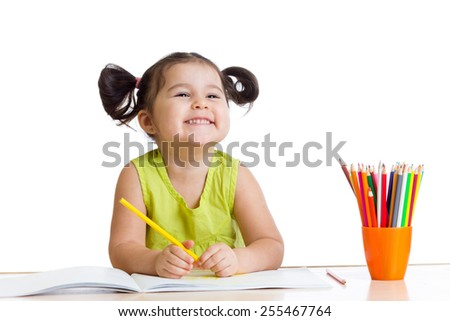 happy kid girl drawing with colourful pencils - stock photo