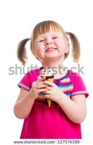 happy kid girl eating ice cream in studio isolated - stock photo