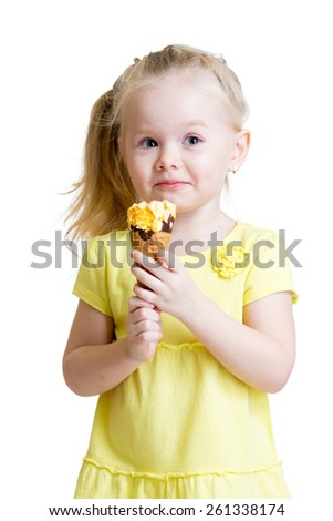 happy kid girl eating ice-cream in studio isolated - stock photo