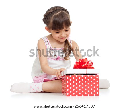happy kid girl holding gift box isolated on white