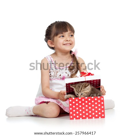 happy kid girl opening gift box with cat kitten