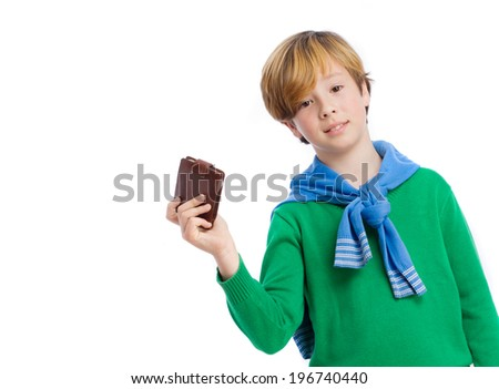 Happy kid holding a leather wallet - stock photo