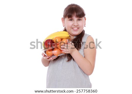 Happy kid holding fruit bowl - stock photo