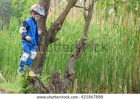 happy kid left his bicycle and resting on a tree - stock photo