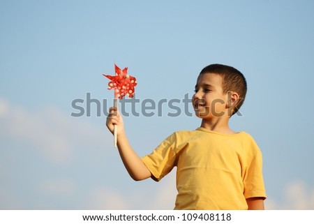 Happy kid on beautiful field - stock photo