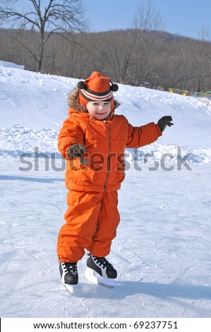 happy kid on skate in the outdoor rink