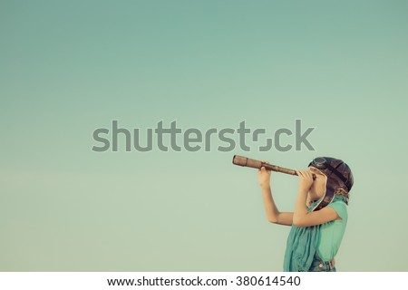 Happy kid playing outdoors. Travel and adventure concept - stock photo